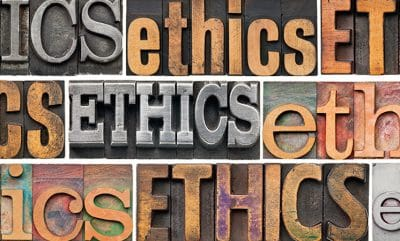 Carved metal and wood lettering of word ethics