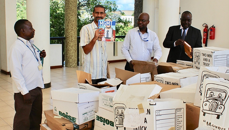 Professors receiving a delivery of international business textbooks at Dar es Salaam University