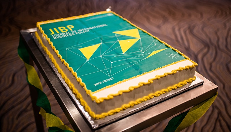 birthday cake with the journal of international business policy's cover design