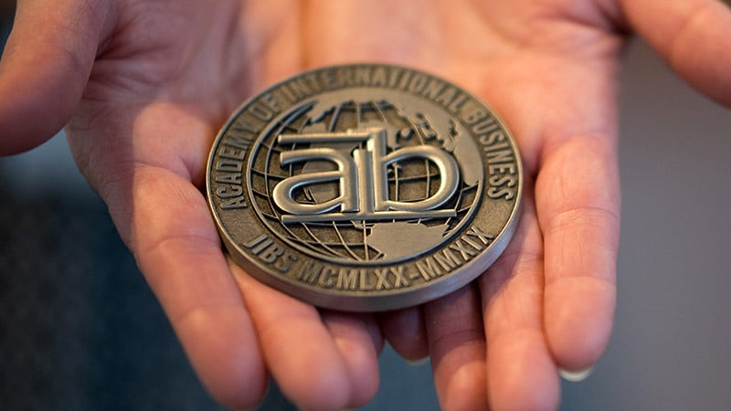 award medal with aib logo