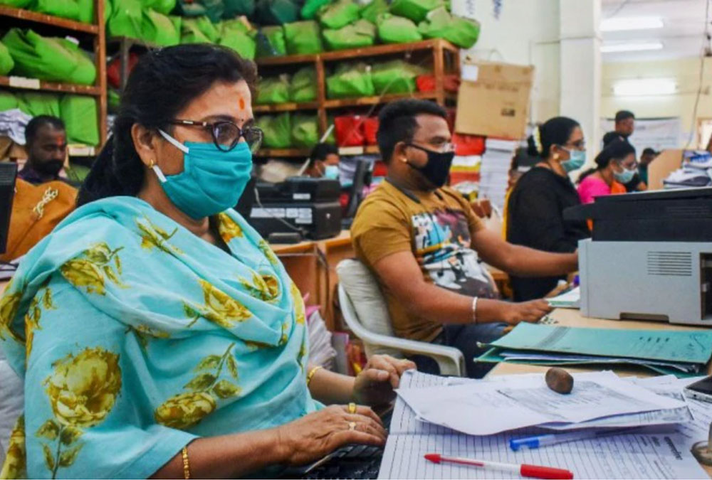 Indian office workers wearing masks to prevent coronavirus transmission
