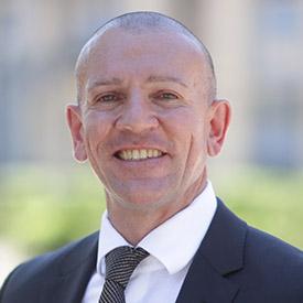 executive board member andrew delios