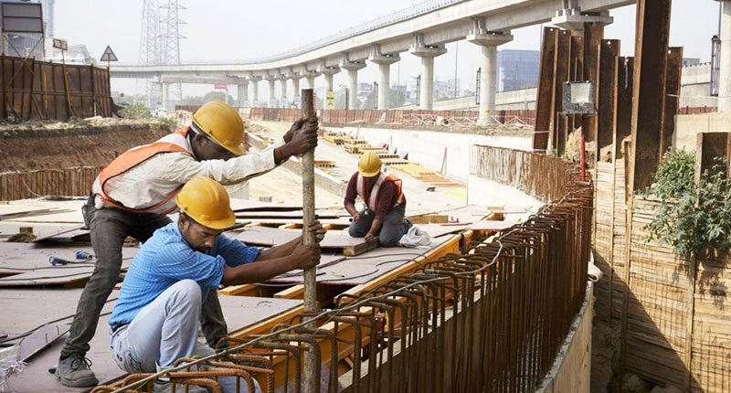 Workers on a major construction site in India